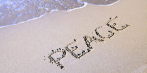 Care plan peace of mind - beach scene with word peace etched in the sand